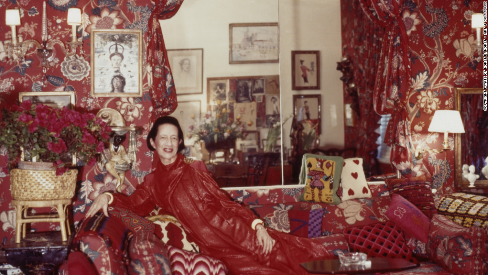 "Diana Vreeland in her famous red living room, nicknamed ""a garden in hell."""