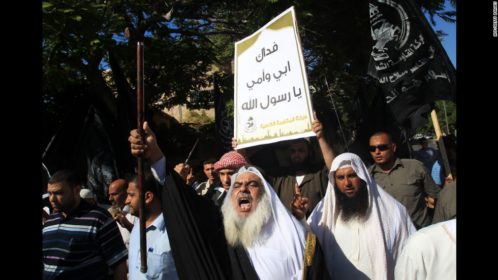 A Palestinian man holds a placard praising Islam's prophet Mohammed during a demonstration against the film on Wednesday in front of the United Nations headquarters in Gaza City.