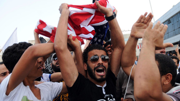 Protesters shout outside the U.S. Embassy in Tunis, Tunisia, on Wednesday, September 12.