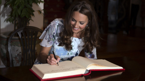 Catherine signs the visitors' book at Eden Hall on Wednesday.