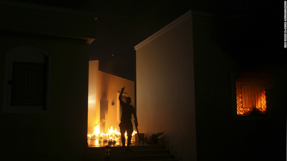 A protester reacts as the U.S. Consulate in Benghazi is seen in flames Tuesday night.