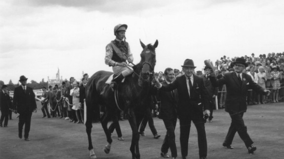 The last horse to win the Triple Crown was Nijinsky in 1970, seen here being led at Ascot by a different O