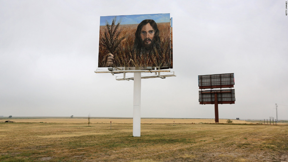 "A billboard, ""Jesus in the Wheat,"" stands alongside Interstate 70 on August 24 in Colby, Kansas. The billboard was erected by local residents Tuffy and Linda Taylor. ""We just put it up there to minister,"" Linda Taylor told the Hays Daily News."
