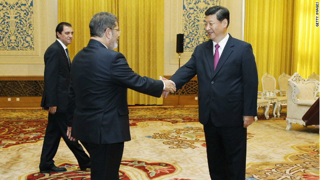 China's Xi Jinping (right) pictured on August 30 meeting Egyptian President Mohamed Morsi in Beijing.