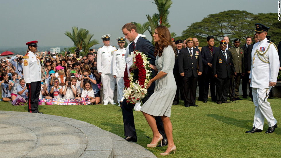 Britain's Prince William and his wife, Catherine, lay a wreath to pay their respects to WWII dead at the Kranji War Cemetery in Singapore Thursday.