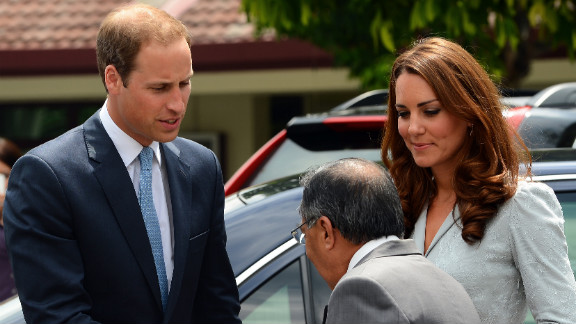 Britain's Prince William and his wife, Catherine, meet Richard Robless, council member of Hospis Malaysia, in Kuala Lumpur on Thursday.