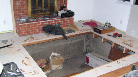 The point of no return: Once there's a huge hole in your living room, might as well drop a hot tub into it.