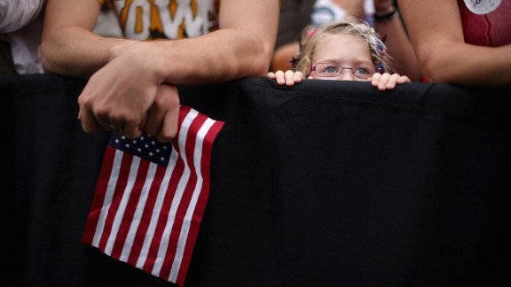 A girl listens to President Obama speak at the University of Iowa on Friday.
