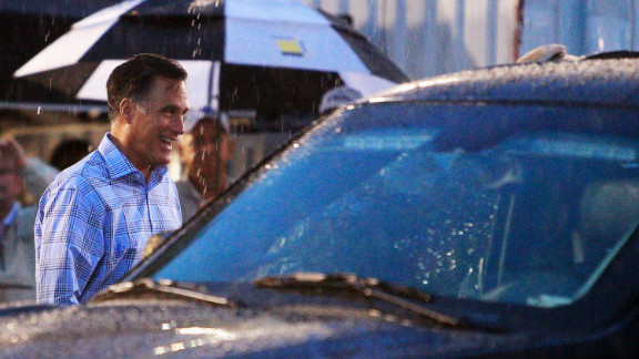 Mitt Romney walks through the garage area during a rain delay before the start of the NASCAR Sprint Cup Series Federated Auto Parts 400 at Richmond International Raceway on Saturday, September 8, in Richmond, Virginia.