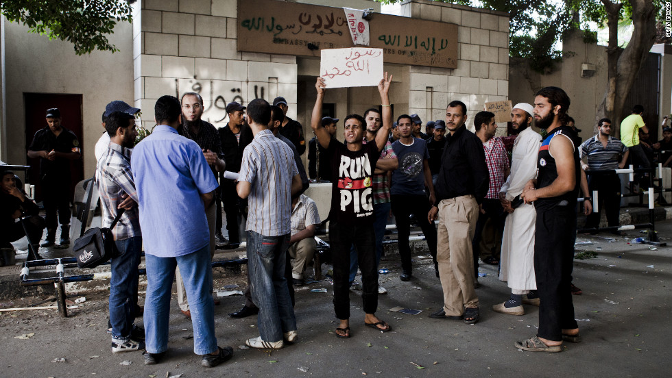 Egyptian protesters gather in front of the U.S. Embassy the morning after it was vandalized by protesters during a demonstration on Wednesday in Cairo.