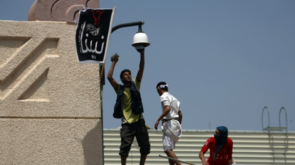 Yemeni protesters try to break the security camera at the U.S. Embassy in Sanaa on Thursday.