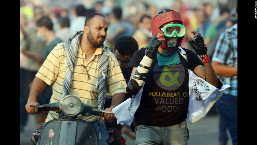 An Egyptian protester wears a makeshift mask and helmet for protection while fighting riot police on Thursday.