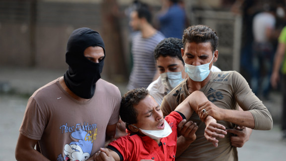 Egyptian protesters help a man who inhaled tear gas during clashes at the U.S. Embassy in Cairo on Thursday.
