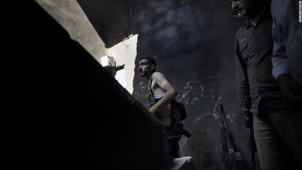 A Syrian rebel fighter takes a position in the Saif al-Dawla neighborhood of Aleppo on Wednesday, September 12.