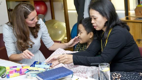 Catherine meets leukemia sufferer Zakwan Anuar, 15, at Hospis Malaysia on September 13, 2012.