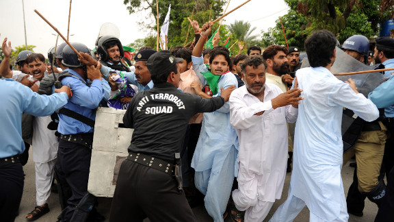 Pakistani soldiers hold back protesters attempting to reach the U.S. Embassy in Islamabad on Friday.