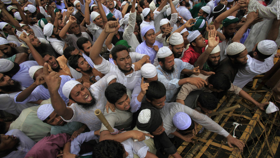 Bangladeshi Muslims attempt to break a police barricade during a protest in Dhaka on Friday.