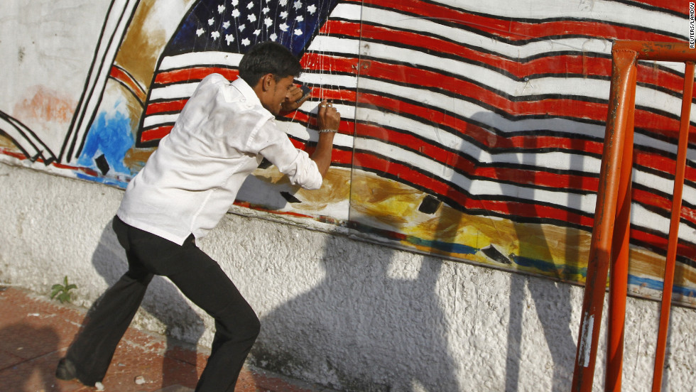 A Muslim protester defaces a mural on a wall of the U.S. Consulate in the southern Indian city of Chennai on Friday.