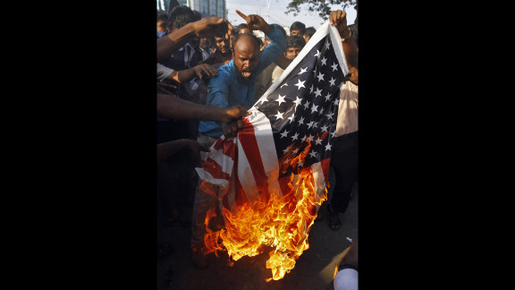 Muslim protesters burn a U.S. flag  outside the U.S. Consulate in the southern Indian city of Chennai on Friday.