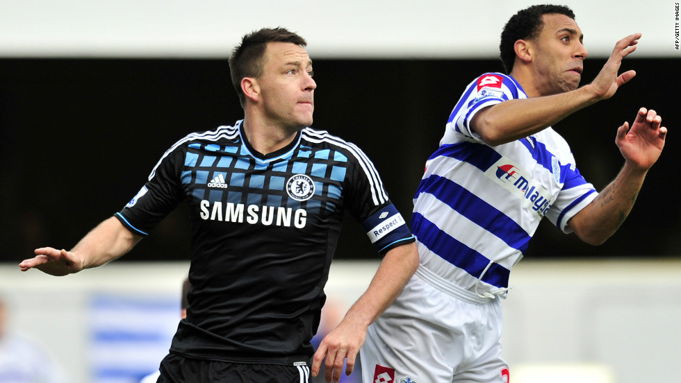 "Chelsea's John Terry (L) was found not guilty in a criminal court of racially abusing Queens Park Rangers defender Anton Ferdinand but received a four-match ban from the FA and a $356,000 fine for calling his opponent a ""f*****g black c***."""