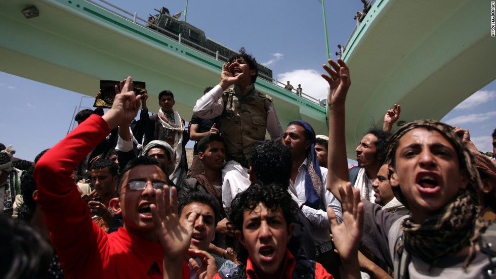 Yemeni protesters shout during a demonstration near the U.S. Embassy in Sanaa on Friday.