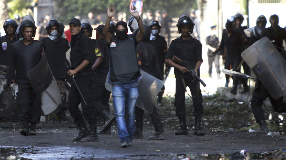 A riot police officer shouts a warning during clashes in Cairo on Friday.