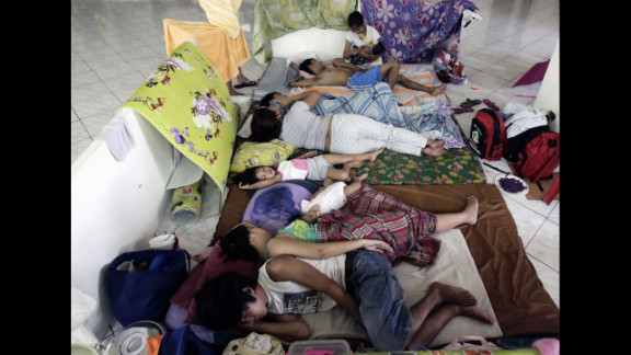 Flood victims rest in an evacuation center after their houses were flooded in San Juan.