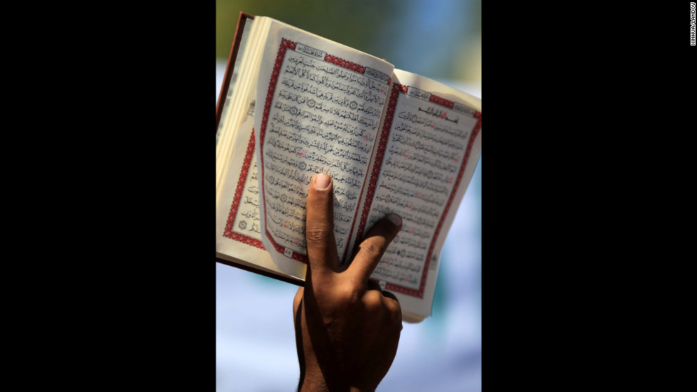 A Jordanian protester holds an Islamic book near the U.S. Embassy in Amman, Jordan, on Friday. Hundreds of members of Jordanian Salafi Movement gathered after Friday noon prayers in protest of a controversial anti-Islam film.