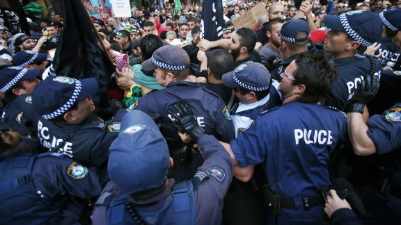 Protesters clash with police on a street in Sydney