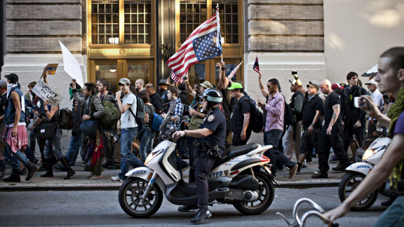 Members of Occupy Wall Street march from Washington Square Park to New York