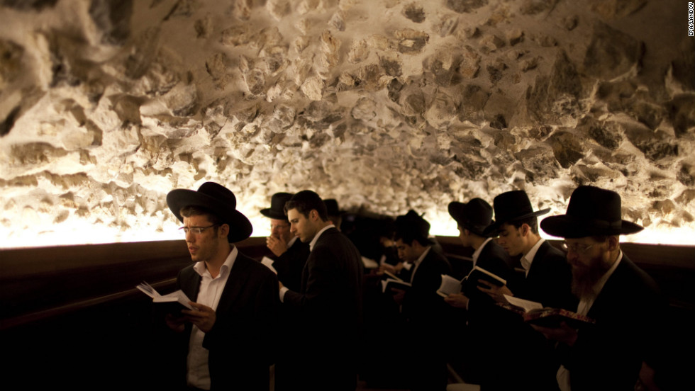 Ultra-Orthodox Jewish men pray all night for forgiveness on Friday.