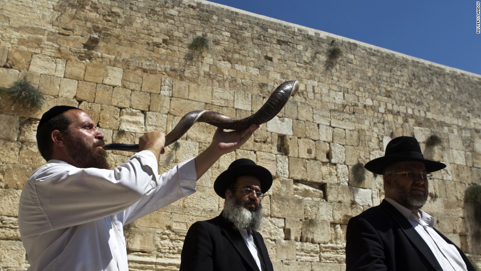 A Jewish worshipper blows the traditional shofar, made from an antelope's horn, near the Western Wall in Jerusalem's Old City on Friday, September 14.
