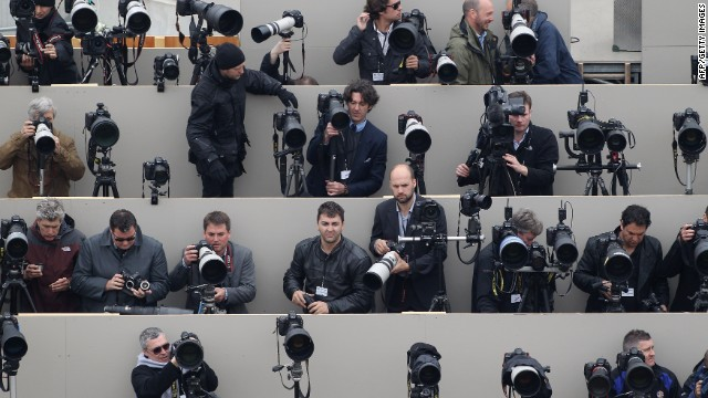 Press photographers wait on a temporary stand on the Queen Victoria Memorial in front of Buckingham Palace for Britain's Prince William and Kate, Duchess of Cambridge to appear on the balcony following their wedding on April 29, 2011.AFP PHOTO/WPA POOL/Oli Scarff (Photo credit should read OLI SCARFF/AFP/Getty Images)