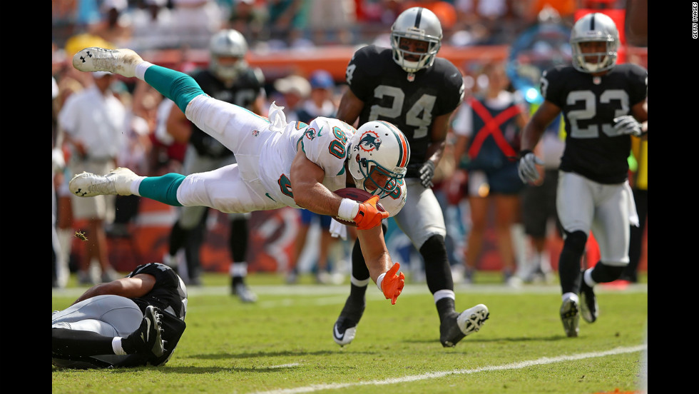 Tight end Anthony Fasano of the Miami Dolphins dives for a touchdown against the Oakland Raiders on Sunday at Sun Life Stadium in Miami Gardens, Florida.
