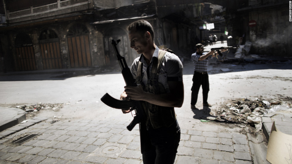Syrian rebels take position during clashes with regime forces in the northern city of Aleppo on Friday, September 14. Syrian regime forces used fighter jets and helicopter gunships to pound the city and province of Aleppo, where fierce clashes raged around a military airport, monitors said.