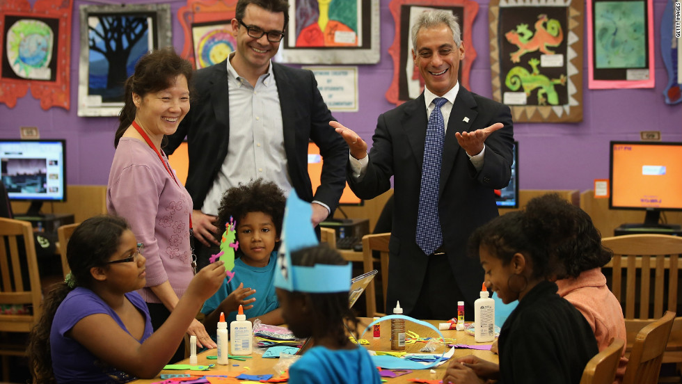 "Chicago Mayor Rahm Emanuel, right, visits schoolchildren at Woodson Regional Library on Monday. The library is one of 78 public libraries in the city serving as ""safe havens"" for students who are not in school because of the strike."