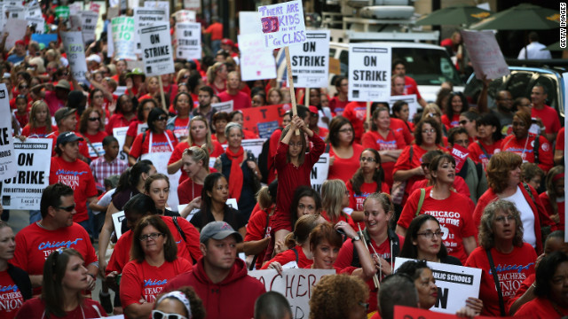Thousands of teachers and their supporters march in front of the Chicago Public Schools headquarters on September 10. With more than 350,000 students, Chicago is home to the nation's third-largest school system.