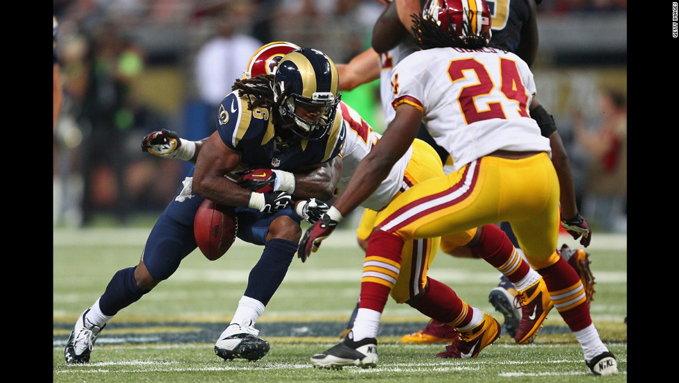 Daryl Richardson of the St. Louis Rams fumbles the ball against the Washington Redskins on Sunday.
