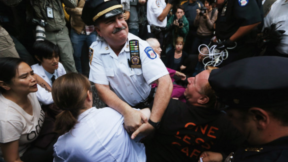 "Protesters affiliated with Occupy Wall Street are arrested while attempting to form a ""People"