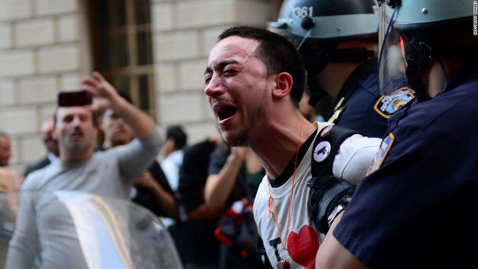 A participant in the Occupy Wall Street protest is arrested during a rally to mark the one-year anniversary of the movement in New York on Monday, September 17, 2012.