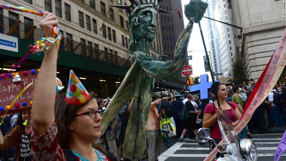 Participants in Occupy Wall Street take part in a rally to mark the one-year anniversary of the movement on Monday.