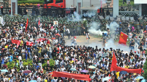 Police fire tear gas to disperse the crowds in Shenzhen, south China