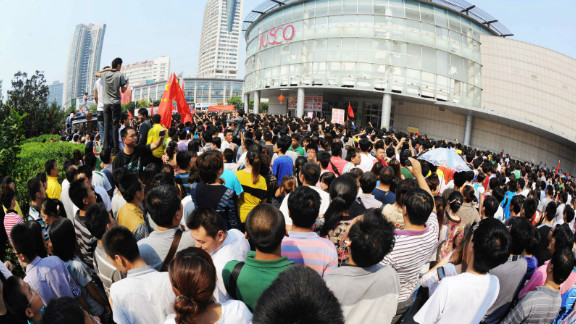 Chinese protesters gather outside a JUSCO, a Japanese department store, in Qingdao, northeast China