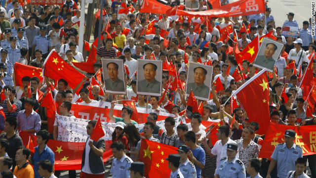 Chinese demonstrators carry anti-Japan banners and shout slogans on September 16.