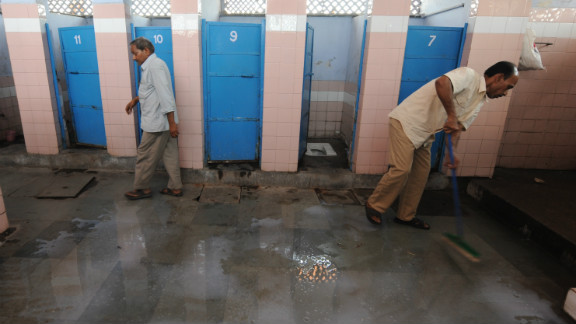 A cleaner mops up in a toilet complex run by Sulabh International at a railway station in New Delhi.