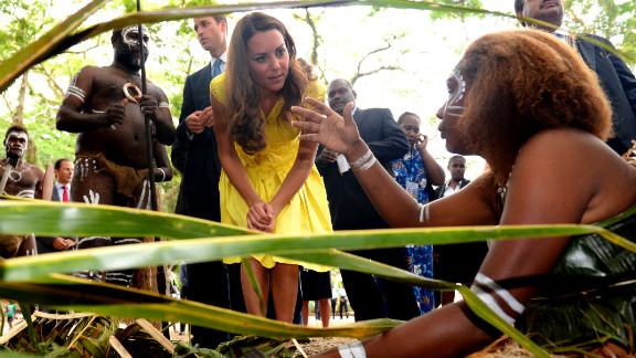 Catherine, Duchess of Cambridge, and Prince William speak with traditional weavers during a visit to a village in the Solomon Islands on Monday, September 17.