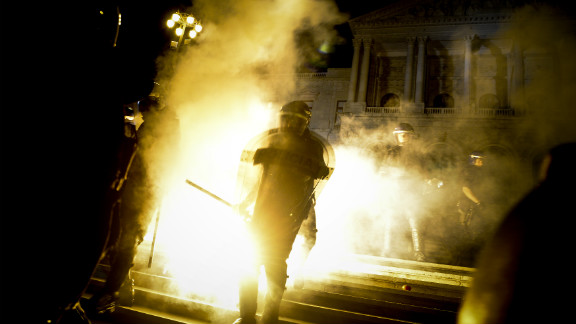 Riot police stands in front of the Portuguese Parliament during a protest in Lisbon on September 15.