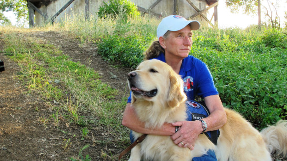 """Mary Cortani is a former Army dog trainer who started Operation Freedom Paws, a nonprofit that helps war veterans <a href=""""http://www.cnn.com/2012/06/07/us/cnnheroes-cortani-veterans-dogs/index.html"""">train their own service dogs</a>. Since 2010, she has worked with more than 80 veterans who have invisible wounds such as post-traumatic stress disorder. """"I'm hoping this brings awareness to the world that PTSD is real and that we will be able to reach more veterans who so desperately need help,"""" Cortani said. <a href=""""http://www.cnn.com/2012/11/26/us/gallery/heroes-cortani/index.html"""" target=""""_blank"""">See more photos of Mary Cortani</a>"""