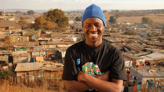"""Thulani Madondo <a href=""""http://www.cnn.com/2012/07/12/world/africa/cnnheroes-madondo-kliptown/index.html"""">struggled as a child</a> growing up in the slums of Kliptown, South Africa. Today, his Kliptown Youth Program provides school uniforms, tutoring, meals and activities to 400 children in the community. """"We're trying to give them the sense that everything is possible,"""" he said. <a href=""""http://www.cnn.com/2012/11/26/africa/gallery/heroes-madondo/index.html"""" target=""""_blank"""">See more photos of Thulani Madondo</a>"""