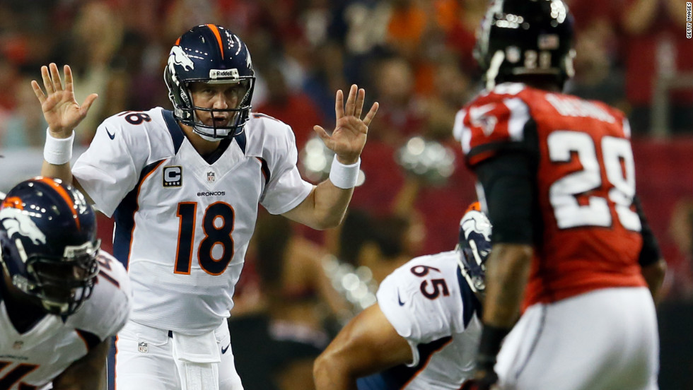 Quarterback Peyton Manning of the Denver Broncos gets ready to start a play during Monday's game against the Atlanta Falcons.